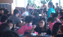 Summer course students eating in hall